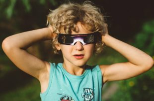 Child wearing eclipse glasses