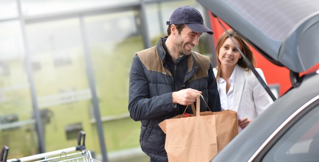 Loading groceries in a car
