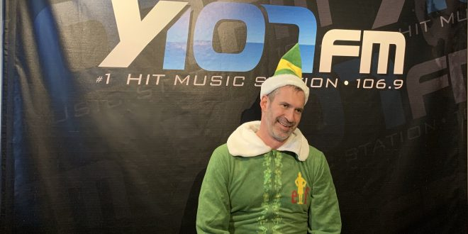 A picture of Cosmo in a elf costume.
