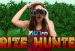 Girl with binoculars on the search with Prizehunter underneath her