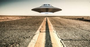 Area 51 scene of UFO hovering over desert highway