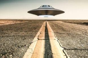 Area 51 scene of UFO hovering over desert highway