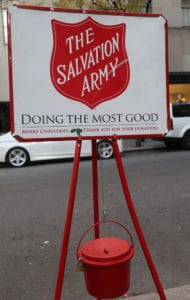 Salvation army red kettle and sign