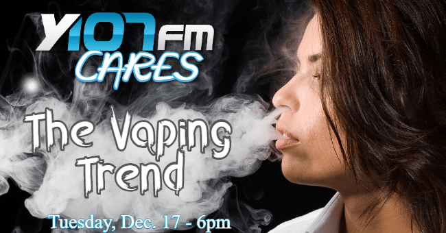 Woman vaping and blowing out vape cloud