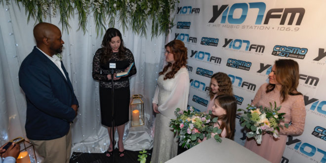 Lisa and Fred Brunston exchange wedding vows in the Y107 studio
