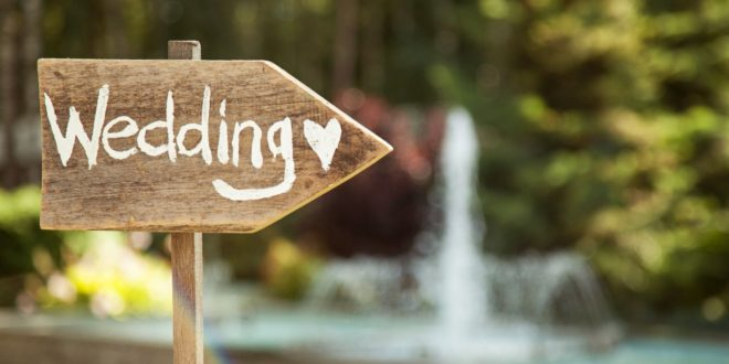 sign pointing to wedding