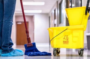 Person mopping floor at hospital