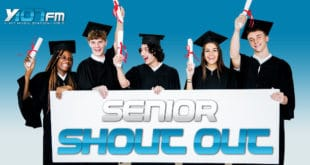 High School Seniors in cap and gown holding Senior Shout Outs sign