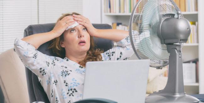 Woman suffering from a summer heatwave