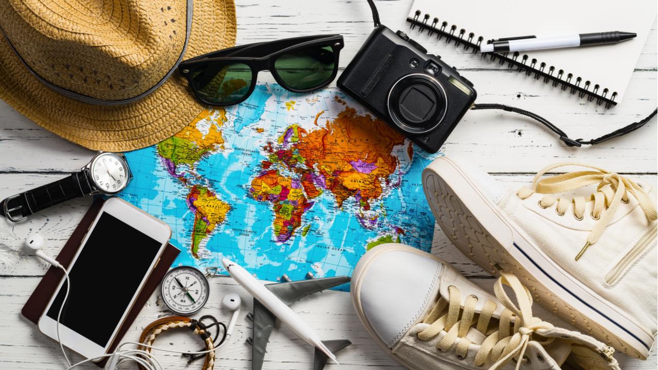 hat, sunglasses, map, shoes, camera, phone, headphones