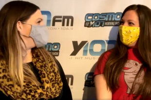 Lauren and Kristin masked up talking about International Women's Day in front of the Y107 banner