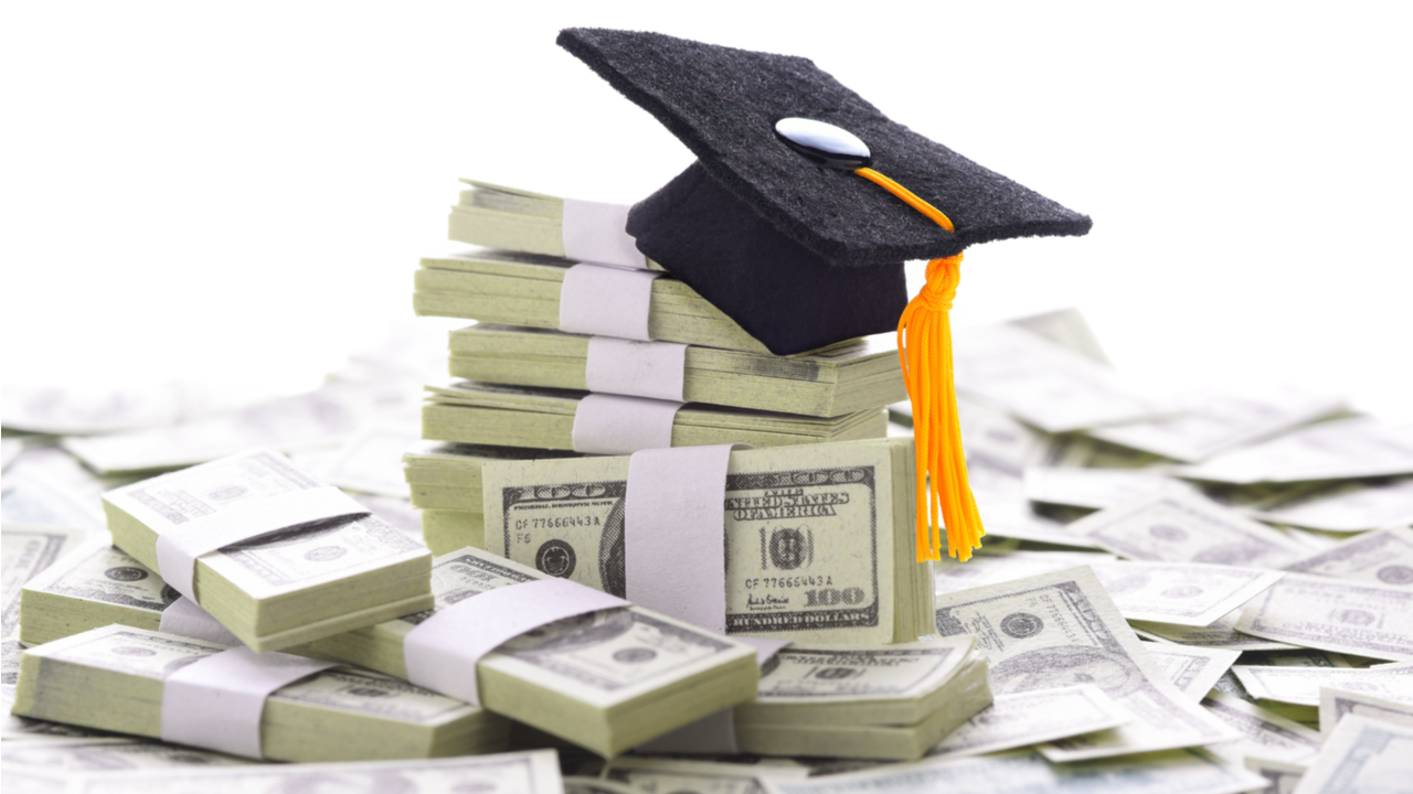 Mortarboard on a pile of money