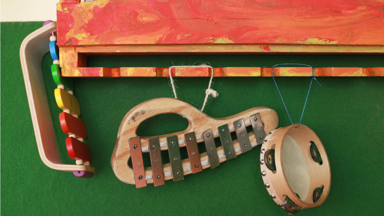 Wooden ecological natural toy music instruments hanging in a classroom