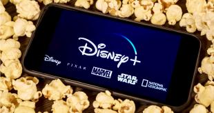 Disney Plus on smartphone with popcorn.