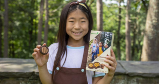 Smiling Girl Scout shows off newest brownie-inspired cookie